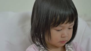 4K : Little Asian child sick with flu sneezing