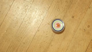 4K : Top view of antique top spinning on wooden floor, Cultural toy of Japanese