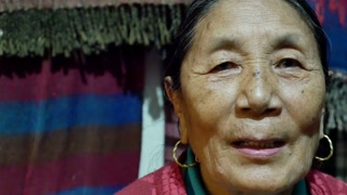 4K Video close up the face of smiling old Tibetan woman