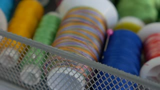 4K : Zoom in shot of colorful spools of thread in textile factory, Manufacture industrial textile spinning