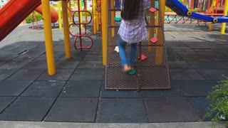 Asian children play on the playground