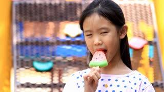 Asian girl enjoy eating with icecream