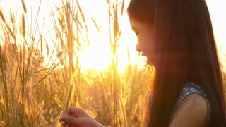 Asian girl with healthy long hair enjoying in the meadow, Slow motion shot