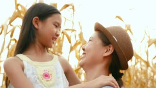 Asian girl with her mother enjoying in the meadow together, Slow motion shot