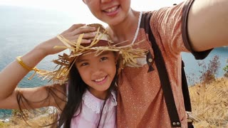 Asian mother and daughter taking selfie photograph together, Happy family concept, Slow motion shot.