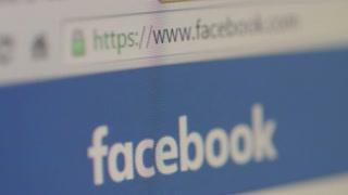 Close up of Facebook homepage, Rack focus