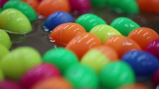 Colorful of lucky balls or eggs floated in water for gamble