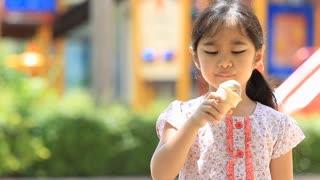 Happy Asian child enjoy eating icecream