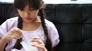 Happy Asian girl enjoy eating ice-cream