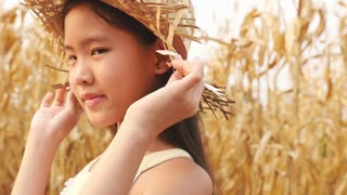 Happy Asian girl runing in the corn field, Slow motion shot