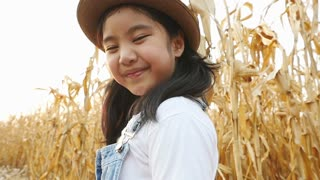 Happy Asian girl walking in corn field, Slow motion shot