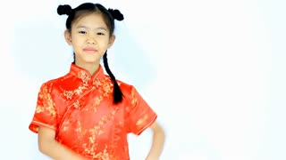 Happy little Asian Chinese child in traditional dress