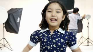 Little Asian model kid with fashion photo shooting