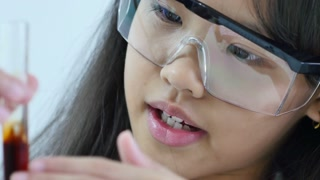 Little Asian student girl making science experiments. Education, Close up shot