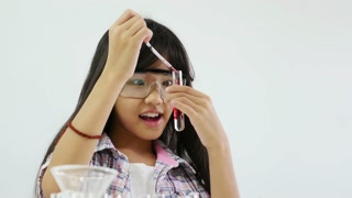 Little Asian student girl making science experiments. Education