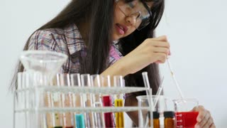 Little Asian student girl making science experiments