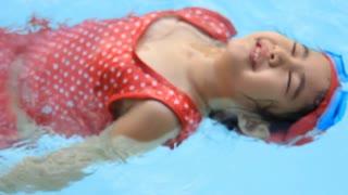 Little girl in swimming pool, Happy summer.