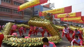 NAKHONSAWAN, THAILAND - FEBRUARY 11: Group Parade of Golden dragon show in Nakhonsawan Chinese New Year celebrations festival on February 11, 2015 in Nakhonsawan, Thailand