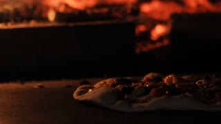 Pizza in a wood fire oven