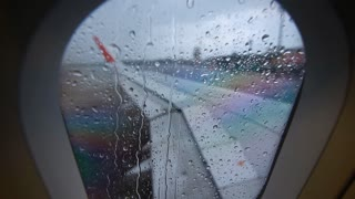 Rain drop on plane window