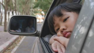 Sadness Asian girl looking out from car window