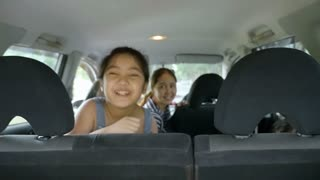 Slow motion of Happy Asian family on mini van are smiling and preparing for travel on vacation