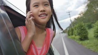 Slow motion of little Girl Playing on Window Car, Family Traveling on Countryside.