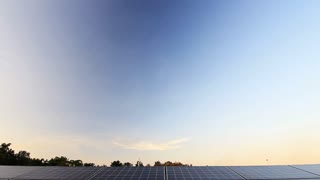 Solar panel plant, ecology power, Tilt down shot