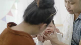 4K Asian parents take care newborn baby