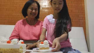 4K : Asian Senior woman celebrating birthday with family