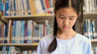 4K Asian teenager student reading a book in school library for inspiration,Shoot wit natural light, Slow motion shot