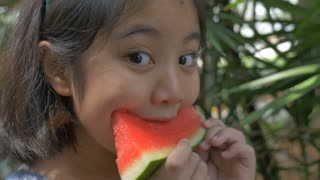 4K : Close up of Asian child girl eating delicious water melon