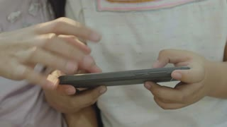 4K Closeup hands of Asian girls playing games on smart phone