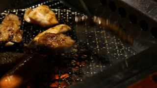 4K Grilled Barbecue Beef Steak cooked in a Japanese restaurant in Tokyo, Japan grilling beef Yakiniku style, Pan shot