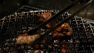 4K Grilled Barbecue Beef Steak cooked in a Japanese restaurant in Tokyo, Japan grilling beef Yakiniku style