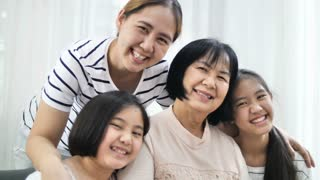 4K Happy Asian family smiling together at home, Multi generation of female, 60 fps