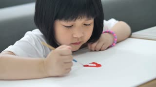 4K : Happy Asian girl draw picture on paper, Happiness moment at home