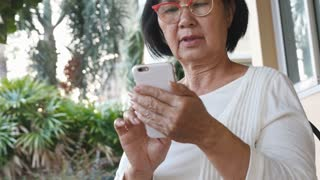 4K : Happy Asian senior woman using video call on smart phone