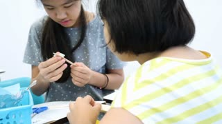 4K Happy Asian student girls making workshop in class