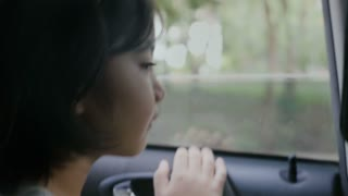 4K : Little girl looking from Window Car, Family Traveling on Countryside, Hand held shot
