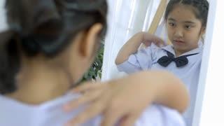 4K : Slow motion Asian student dressing school uniform prepare to school