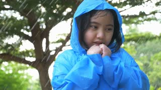 4K : Slow motion Little Asian child sick with flu sneezing in the rain