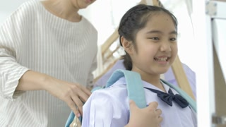 4K : Slow motion of Asian mother helping her's young daughter prepare to school
