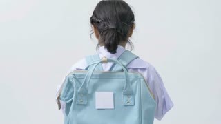 4K : Slow motion of Happy Asian child in school uniform with school bag on white background