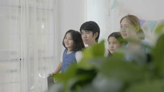 4K : Slow motion of happy Asian family watching exciting movie together