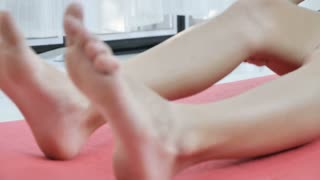 4K Slow motion of Young adult caucasian female warm up be for Yoga