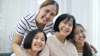 Slow motion 4K Happy Asian family smiling together at home, Multi generation of female