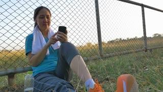 Slow motion Asian sport woman listen the music after exercising, Tilt up shot