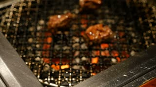Slow motion Grilled Barbecue Beef Steak cooked in a Japanese restaurant in Tokyo, Japan grilling beef Yakiniku style