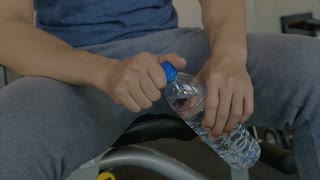 Slow motion of young Asian man drinking water in the fitness gym